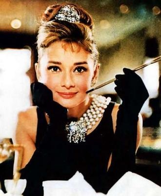 Holly Golightly goes lightly when it comes to packing a purse.